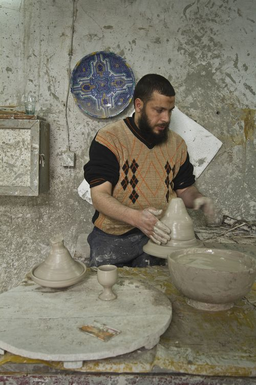 Artisan spins tagine